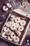 Cookies with cherry filling in the box Royalty Free Stock Photography