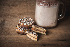 Cookies with chocolate and a bottle of warm cocoa Royalty Free Stock Image