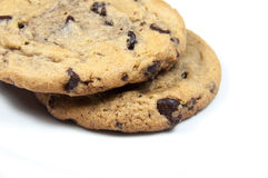 Cookies. 2 chocolate chip cookies stacked on a white background Stock Photos