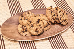 Cookies with chocolate chips on the oval wooden Stock Photo