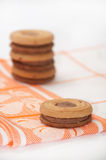 Cookies with chocolate cream on a kitchen tablecloth Royalty Free Stock Photo
