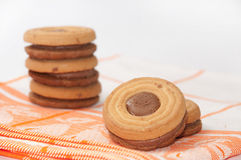 Cookies with chocolate cream on a kitchen tablecloth Stock Image