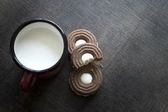 Cookies with chocolate cream and milk Royalty Free Stock Photos