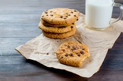 Cookies with chocolate drops and a glass of milk Royalty Free Stock Image
