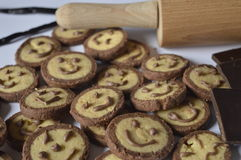 Cookies with chocolate faces, with chocolate smiles Stock Photos