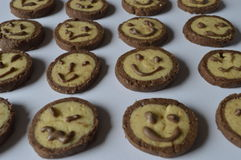 Cookies with chocolate faces, with chocolate smiles. Homemade, round butter cookies with chocolate rant, with brown sugar; vanilla - butter cookies; perfect for royalty free stock photo