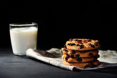 Cookies with chocolate and glass of milk Royalty Free Stock Images