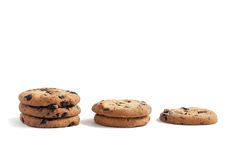 Cookies with chocolate piled into three stacks of three, two and one on a white background. Delicious cookies with chocolate piled into three stacks of three stock image
