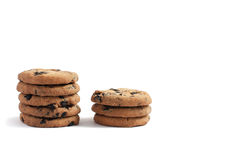 Cookies with chocolate piled into two stacks of five and three on a white background. Delicious cookies with chocolate piled into two stacks of five and three on royalty free stock photo