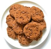 Cookies with chocolate on a white plate. Isolated background stock photo