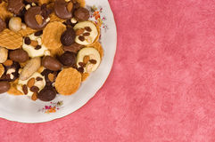 Cookies and chocolates. On a plate with copyspace for your text Royalty Free Stock Photos