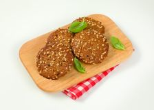 Cookies with chopped nuts and almonds. On wooden cutting board Royalty Free Stock Image