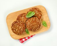Cookies with chopped nuts and almonds. On wooden cutting board Stock Photography