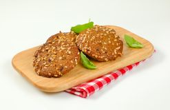 Cookies with chopped nuts and almonds. On wooden cutting board Royalty Free Stock Photography