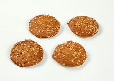 Cookies with chopped nuts and almonds. Four cookies with chopped nuts and almonds on white background Royalty Free Stock Photos