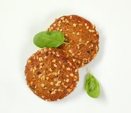Cookies with chopped nuts and almonds. Two cookies with chopped nuts and almonds on white background Stock Photography