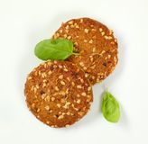 Cookies with chopped nuts and almonds. Two cookies with chopped nuts and almonds on white background Royalty Free Stock Photo