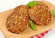 Cookies with chopped nuts and almonds. On wooden cutting board - close up Stock Photography
