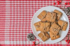 Cookies and Christmas decor on a red napkin. Top view Royalty Free Stock Photography