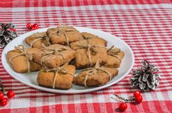 Cookies and Christmas decor on a red napkin. Top view Royalty Free Stock Photo