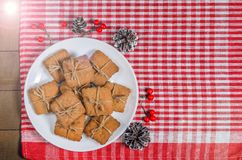 Cookies and Christmas decor on a red napkin. Top view Stock Images