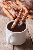 Cookies churros and hot chocolate close-up. Vertical Stock Images