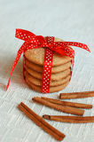 Cookies with cinnamom roll. And a red ribbon Stock Photo
