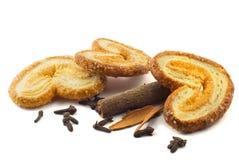 Cookies, cinnamon and clove Stock Photos