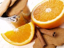 Cookies, cinnamon and  juicy oranges Royalty Free Stock Images