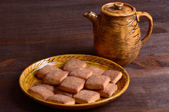 Cookies with cinnamon and teapot Royalty Free Stock Photo