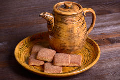 Cookies with cinnamon and teapot Stock Image