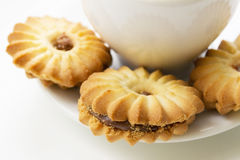 Cookies close-up on a background of a cup of coffee Royalty Free Stock Photography