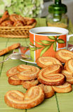 Cookies with coffee. Cookies scattered about a cup of coffee Royalty Free Stock Photos
