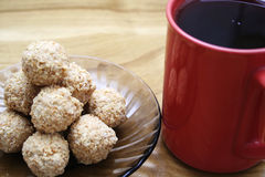 Cookies and coffee. Brown ball cookies and coffee Royalty Free Stock Photo