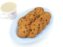 Cookies and Coffee. Chocolate chip cookies in a tray and coffee Stock Image