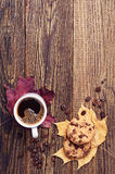 Cookies, coffee and autumn leaves Stock Photos