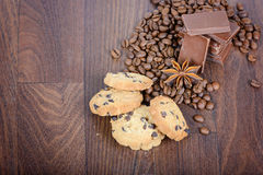 Cookies, coffee beans and chocolate Stock Photos