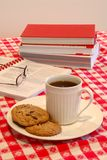 Cookies and Coffee Break. Time - The table is set with plates of cookies and cups of coffee for a late morning snack Royalty Free Stock Images