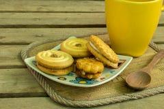 Cookies, coffee, cocoa, wood, ceramics, beverage, breakfast. Stock Image