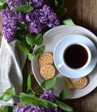 Cookies, coffee and lilac on the table. Royalty Free Stock Photo