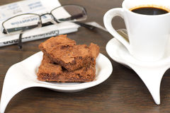 Cookies with coffee and newspaper Royalty Free Stock Photos