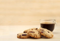 Cookies with coffee on wooden background with free text space. Royalty Free Stock Photography