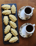 Cookies and coffee on the wooden table. Cookies and two cups of coffee on the wooden surface Stock Images
