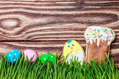 Cookies and colored eggs for Easter Royalty Free Stock Image