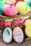 Cookies and colored eggs for Easter Day Stock Photos