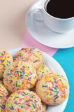 Cookies with colored sprinkles and coffee Royalty Free Stock Image