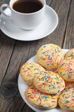 Cookies with colored sprinkles and coffee Royalty Free Stock Photo