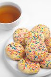 Cookies with colorful sprinkles and tea Royalty Free Stock Photography