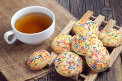 Cookies with colorful sprinkles and tea Royalty Free Stock Image