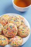 Cookies with colorful sprinkles and tea Royalty Free Stock Photo